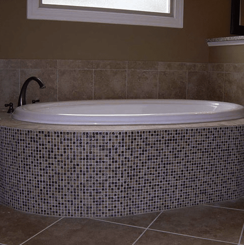 Custom bath surround with glass tile wall in Fuquay-Varina, NC