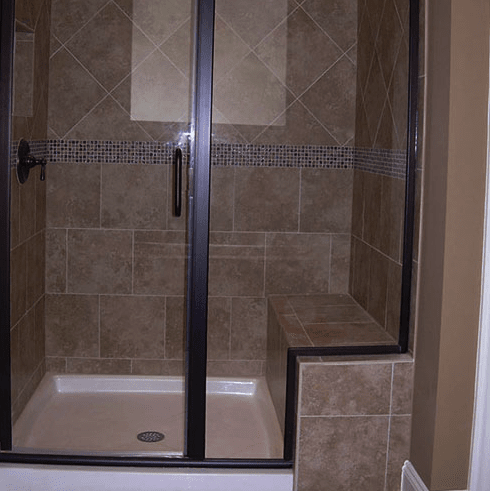 Custom shower with built in bench and black accents in Raleigh, NC