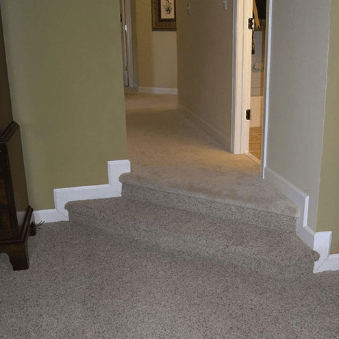 Carpeted stairs in multilevel home in Apex, NC from The Home Center Flooring & Lighting
