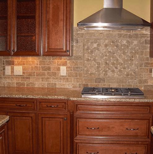Custom tile design above range in Holly Springs, NC from The Home Center Flooring & Lighting