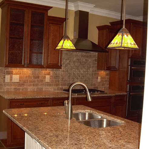 Classic kitchen renovation with natural tone subway tile backsplash in Fuquay-Varina, NC from The Home Center Flooring & Lighting