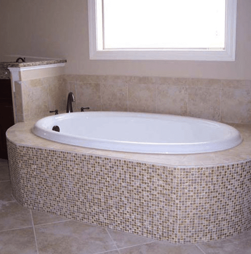 Beautiful glass tile tub surround installation in Raleigh, NC from The Home Center Flooring & Lighting