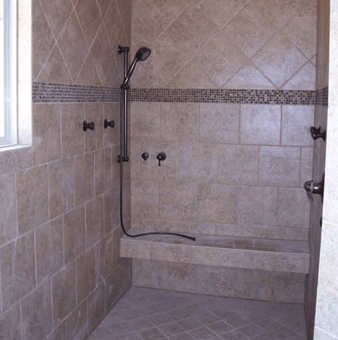 Shower renovation with custom built-in bench in Raleigh, NC from The Home Center Flooring & Lighting