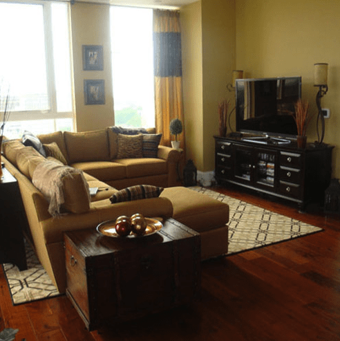Welcoming living space with warm flooring and area rug in Cary, NC