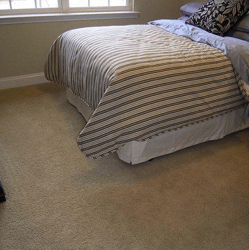 Comfortable new carpet in bedroom in Cary, NC from The Home Center Flooring & Lighting