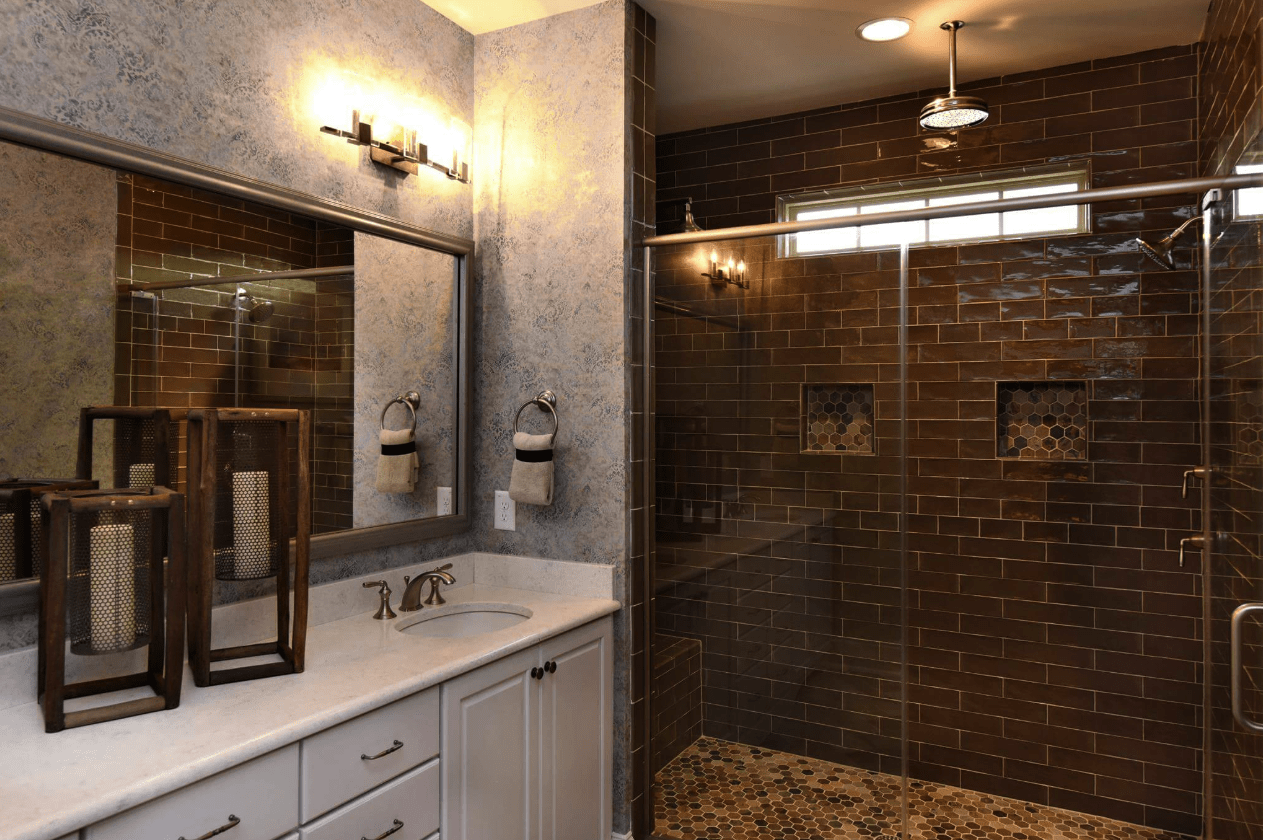 Dark natural tone shower with bright vanity in Raleigh, NC from The Home Center Flooring & Lighting