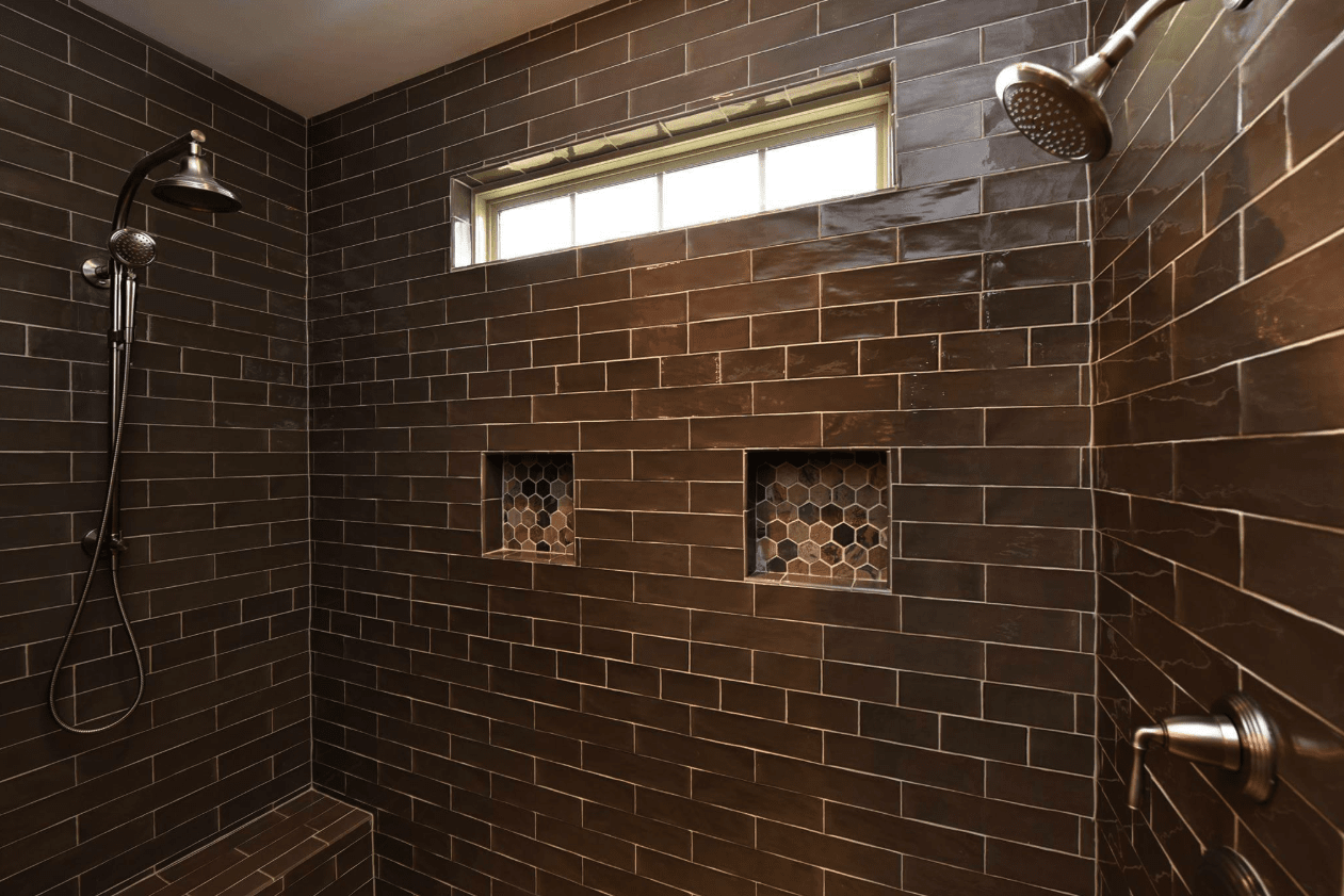 Large double shower with recessed hexagonal tile accents in Apex, NC