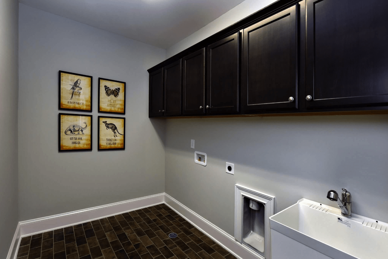 Custom laundry space with new caninets and floors in Holly Springs, NC
