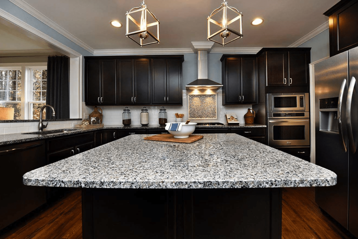 Gorgeous dark cabinetry with bright granite countertops in Cary, NC