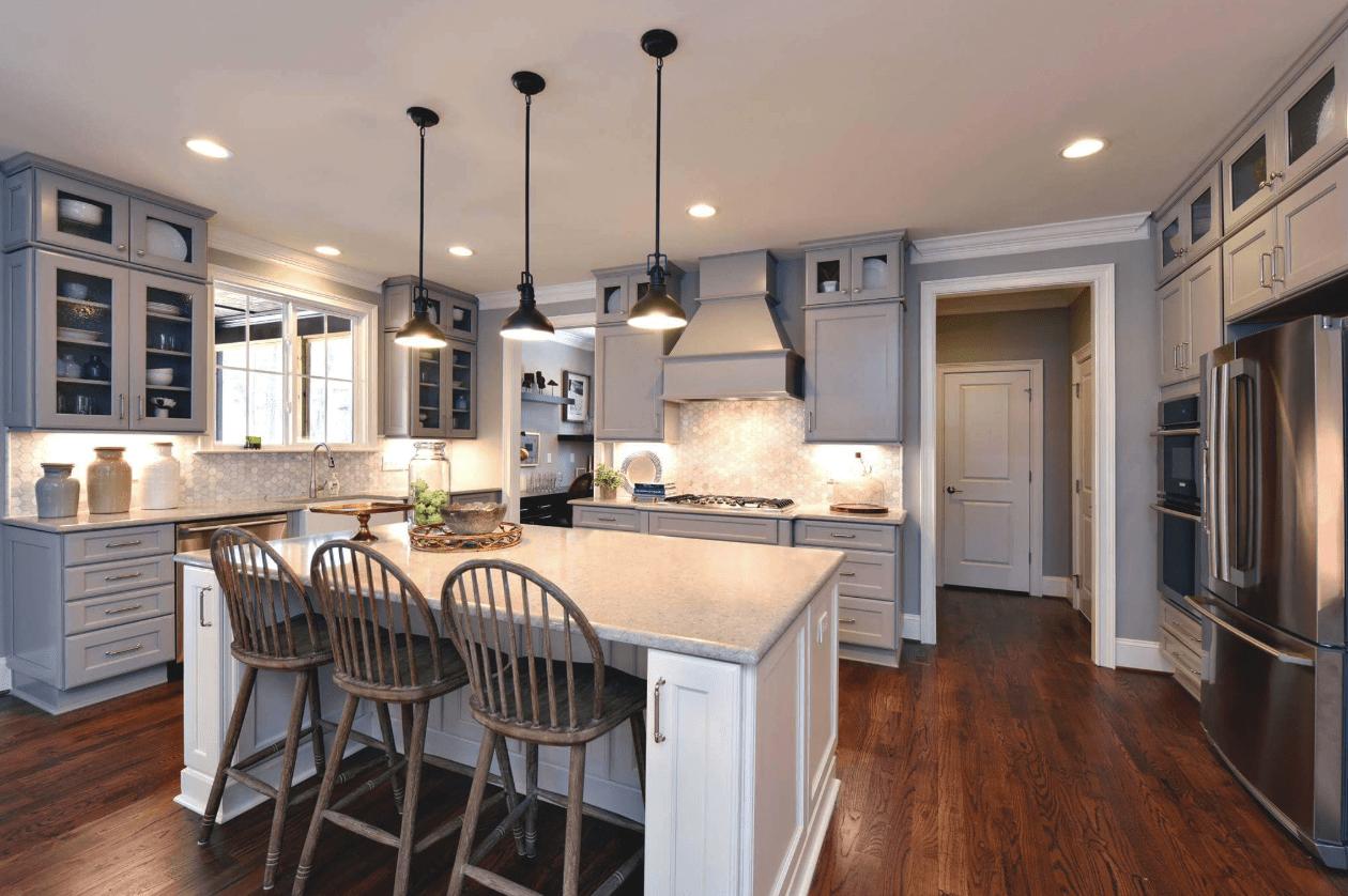 Light kitchen remodel design with dark tone hardwood flooring in Apex, NC