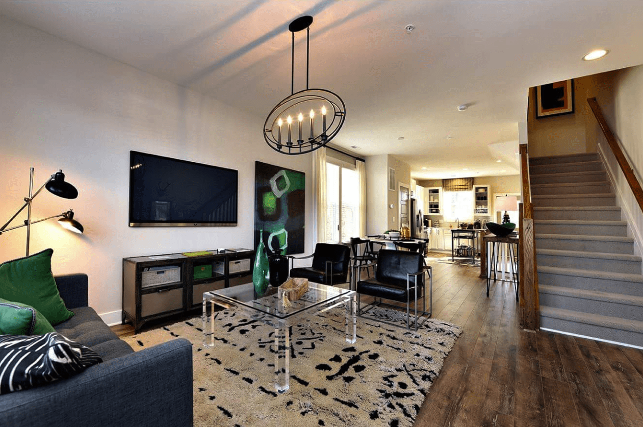 Modern living space with rustic flooring and area rug in Fuquay-Varina, NC