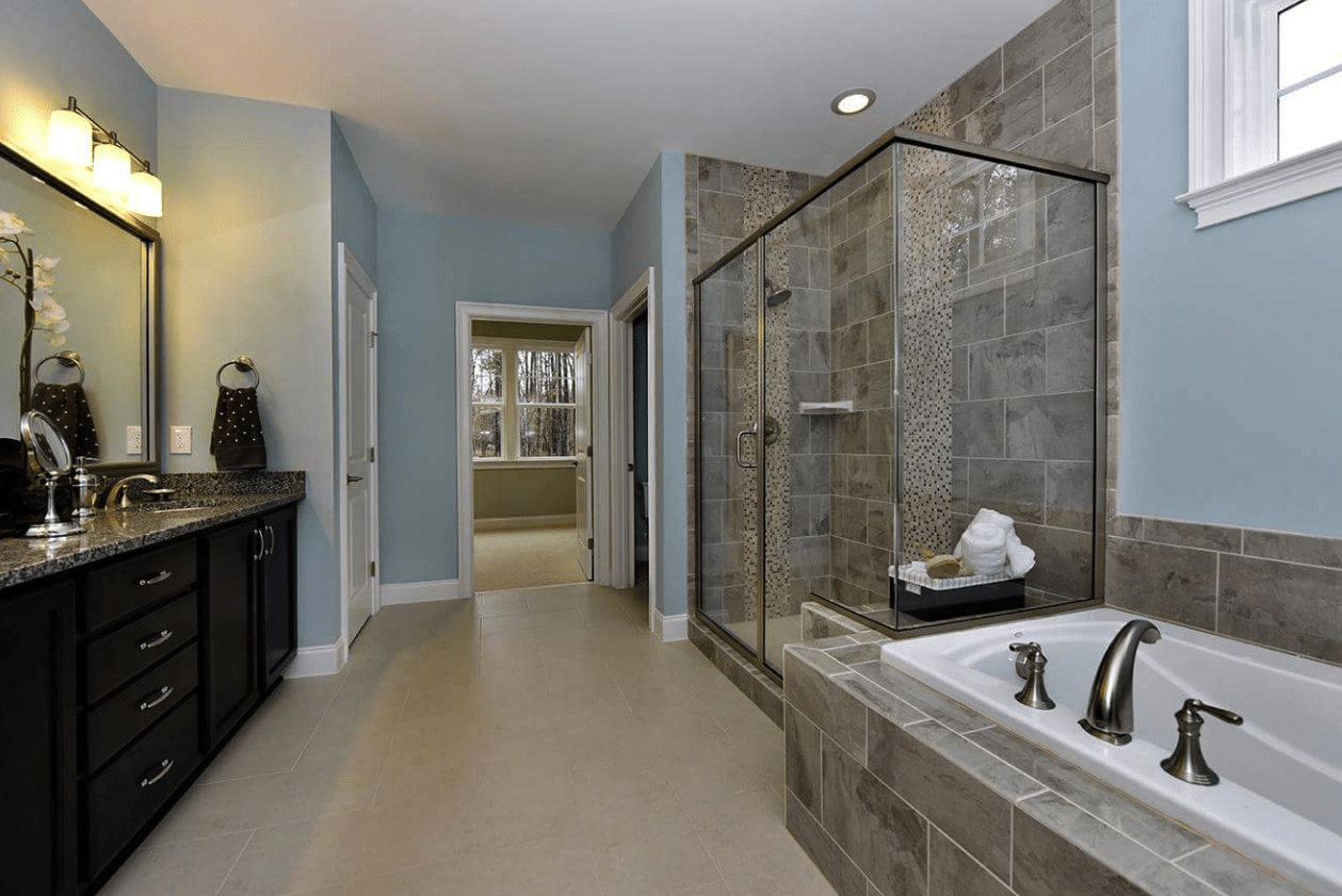 Bathroom renovation with tub and shower install in Fuquay-Varina, NC from The Home Center Flooring & Lighting