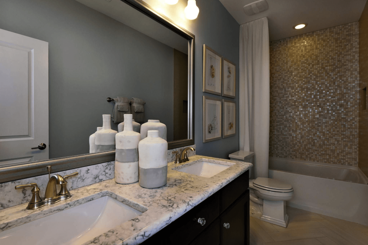 Stone vanity countertop in modern bathroom remodel in Cary, NC from The Home Center Flooring & Lighting