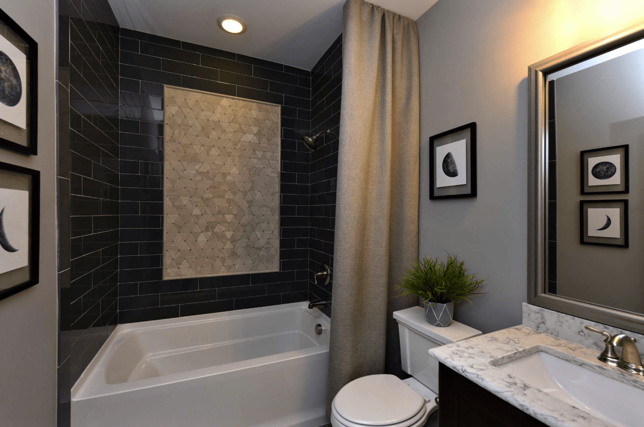 Black tile shower install with custom accent piece in Cary, NC from The Home Center Flooring & Lighting