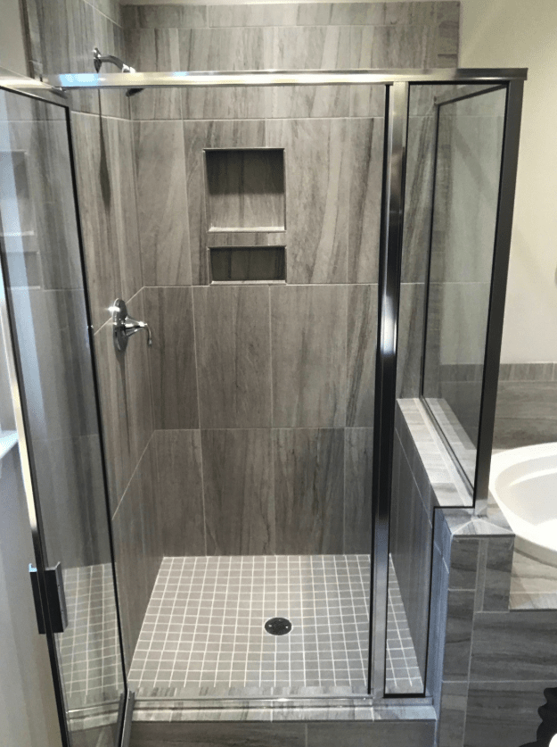 Sleek shower design with custom recessed shelf in Apex, NC from The Home Center Flooring & Lighting