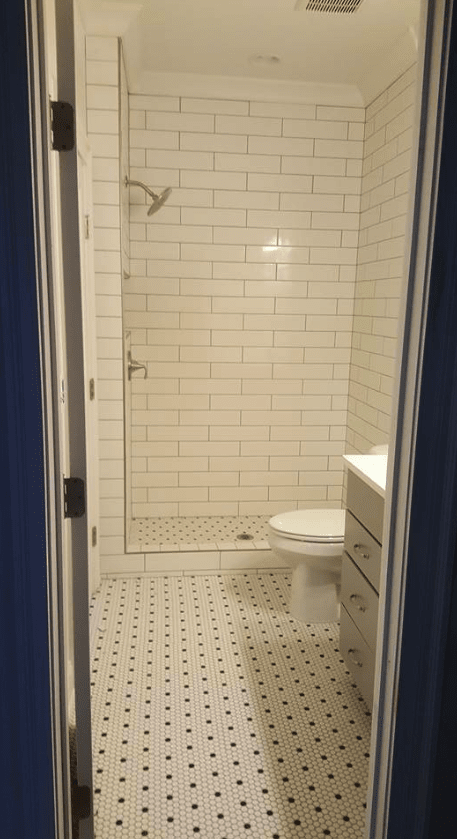 Subway tile shower with matching flooring in Cary, NC from The Home Center Flooring & Lighting
