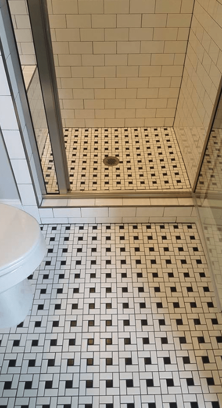 Mosaic tile flooring design in shower in Raleigh, NC from The Home Center Flooring & Lighting