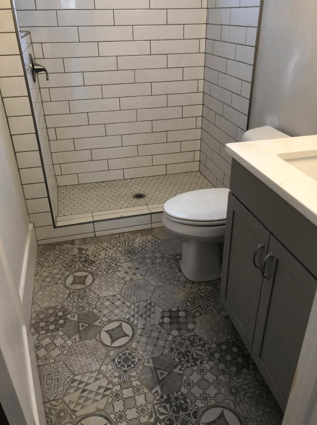 Creative bathroom tile flooring design in Holly Springs, NC from The Home Center Flooring & Lighting