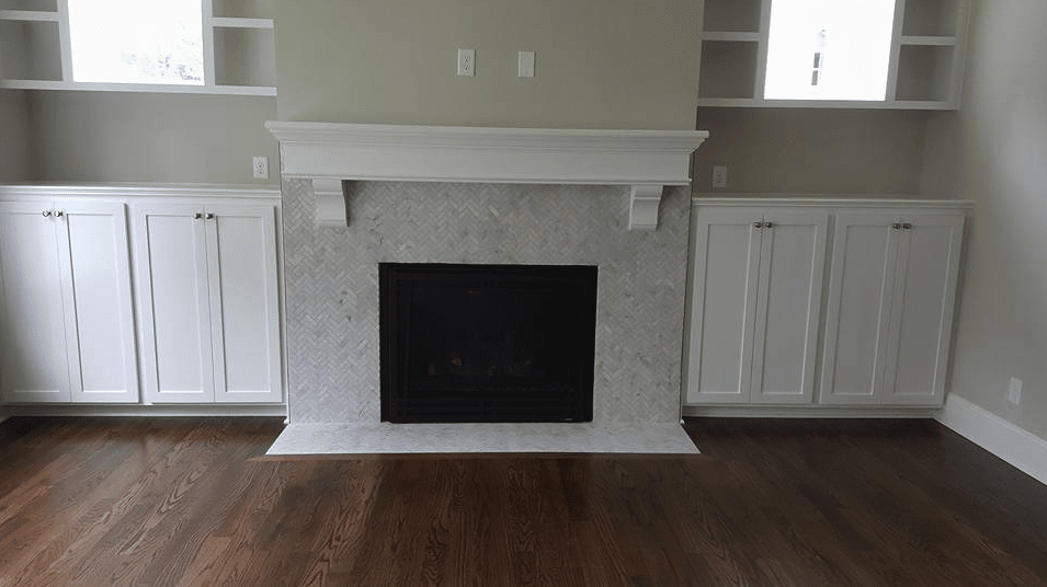 New fireplace installation with white mantel in Fuquay-Varina, NC from The Home Center Flooring & Lighting