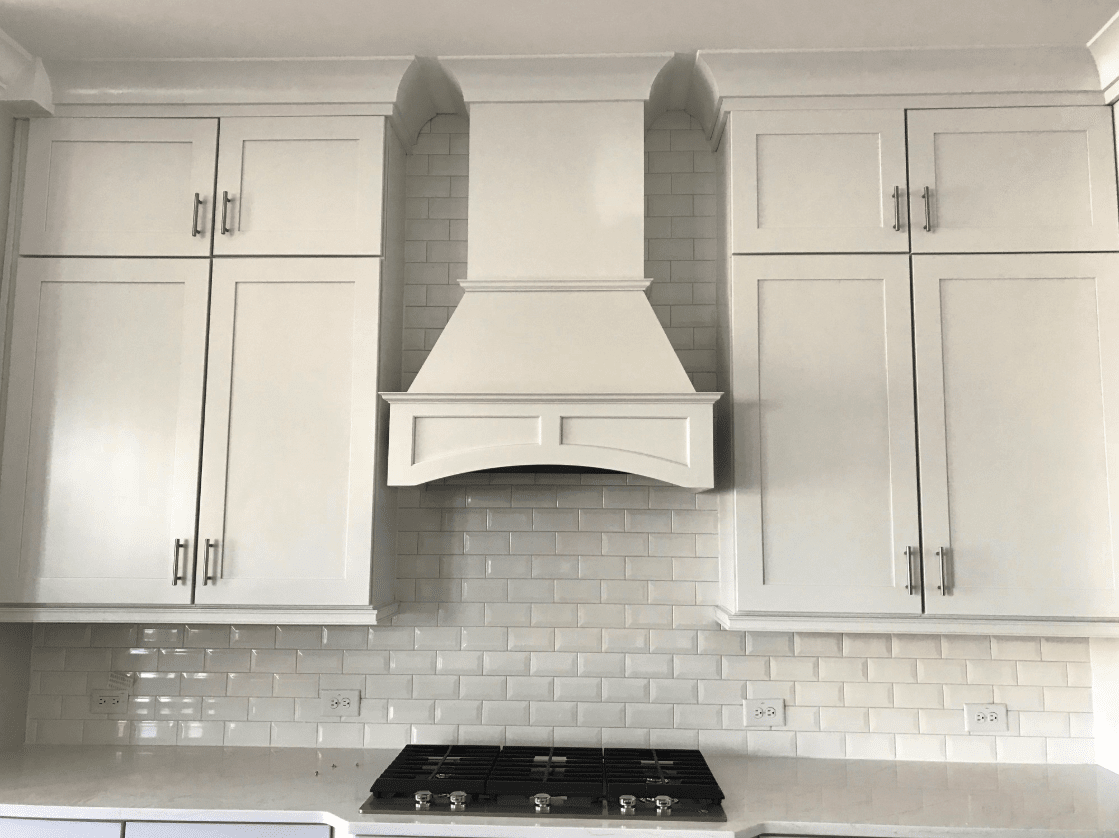 New cabinetry with matching range hood in Cary, NC from The Home Center Flooring & Lighting