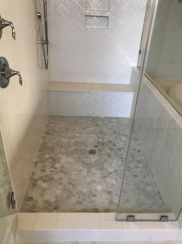 Hexagonal floor tiles in new shower in Apex, NC from The Home Center Flooring & Lighting