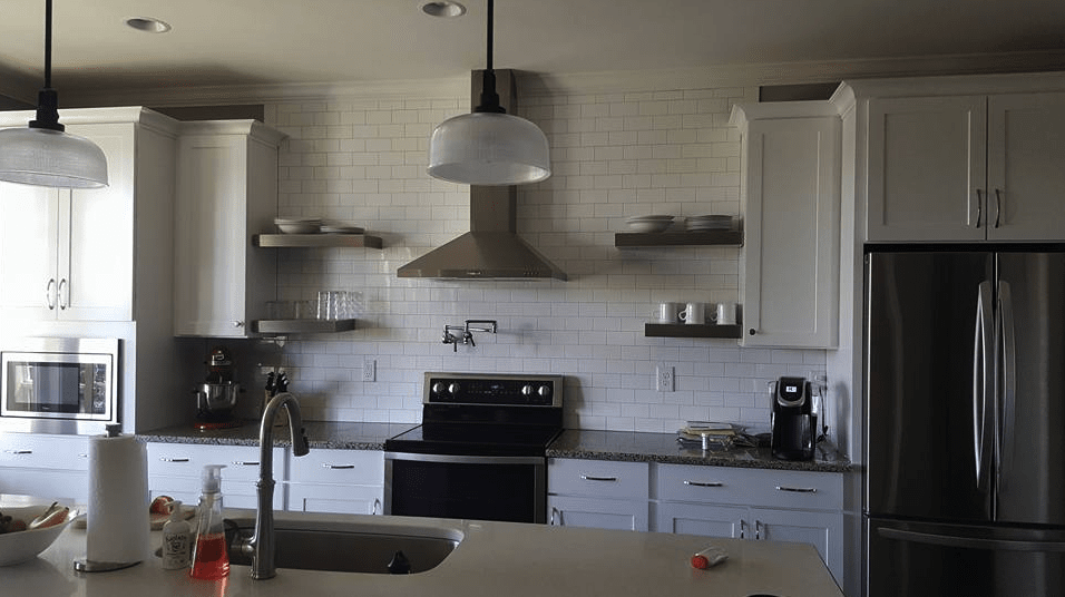 Beautiful modern kitchen with white subway tile and cabinets in Holly Springs, NC