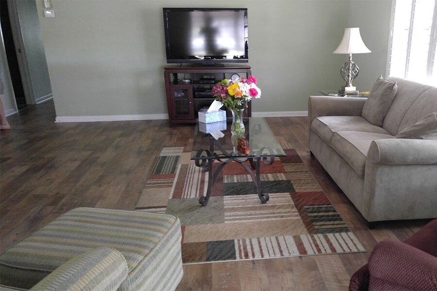 Living room with new custom area rug in Palm City, FL from Carpets Etc