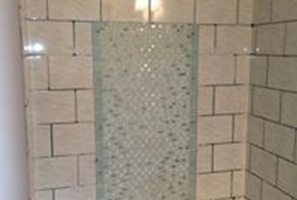 Gorgeous glass tile shower in Winder, GA from Carpets Unlimited