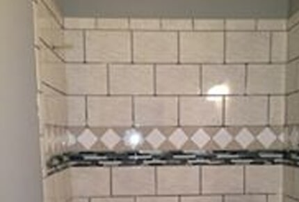 Tile shower with glass tile accents in Watkinsville, GA