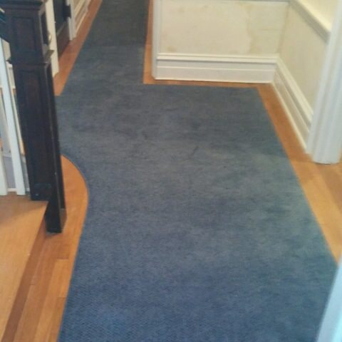 Blue stair runner continuing up flooring in Havertown, PA from Havertown Carpet
