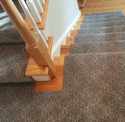 Custom stair runner wrapping up landing in Ardmore, PA from Havertown Carpet