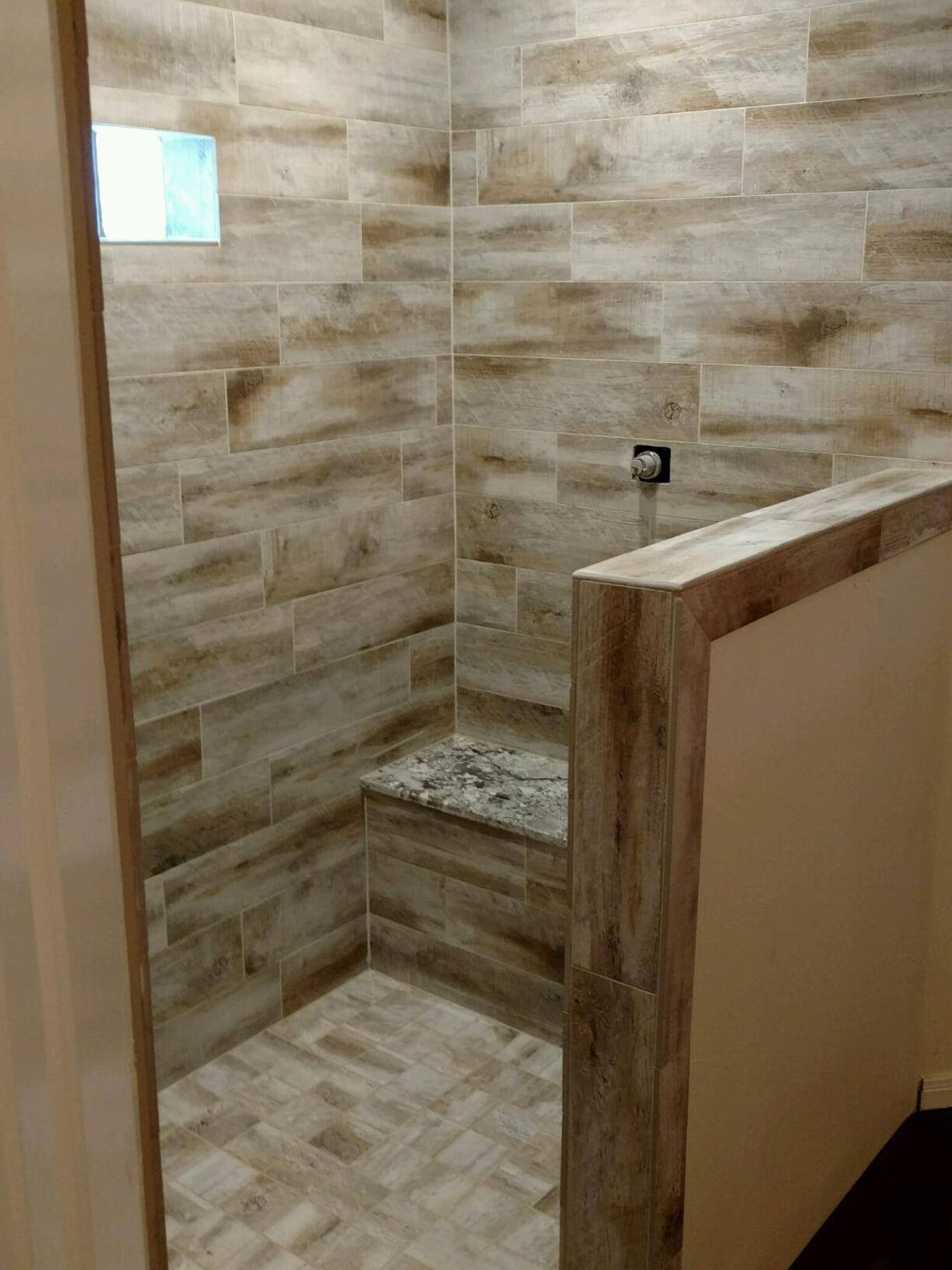 Shower installation with built in bench in Dayton, TX from Baytown Floors