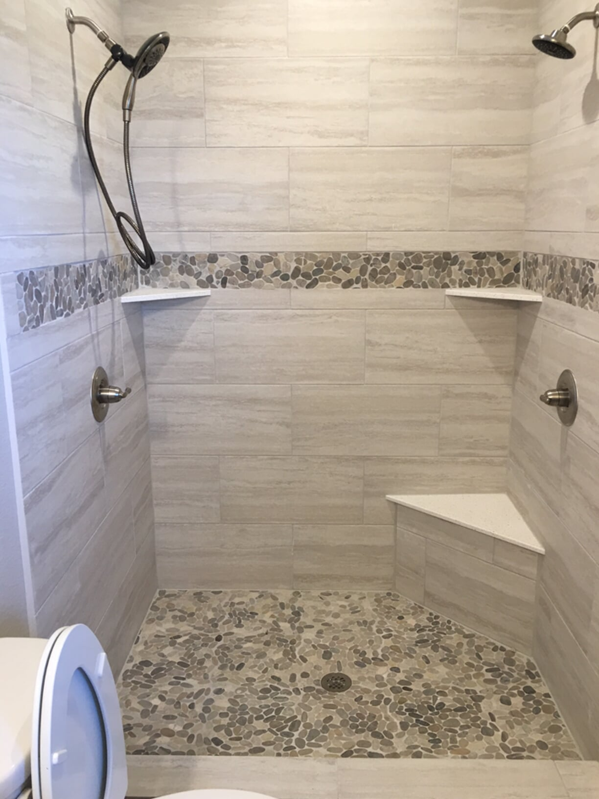 Custom shower with glass tile accents in Pasadena, TX from Baytown Floors
