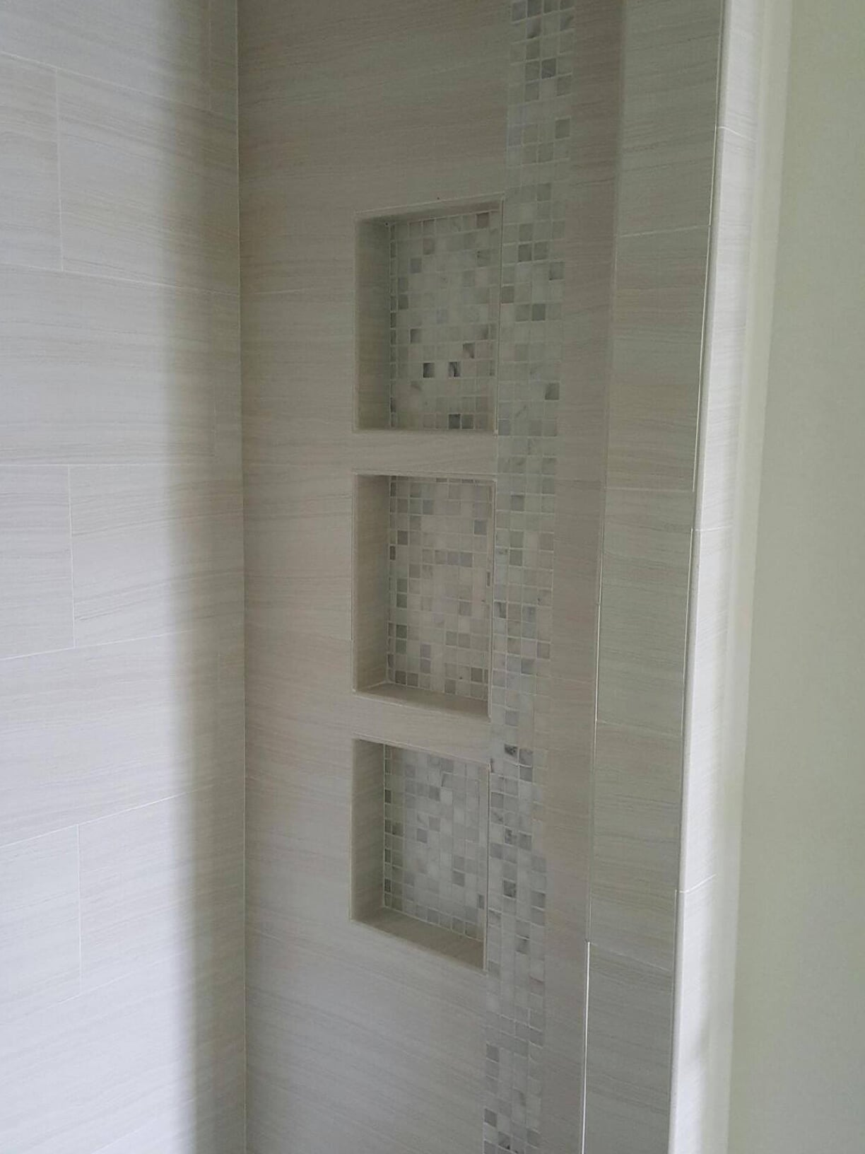 Custom built in shower shelving in Baytown, TX from Baytown Floors