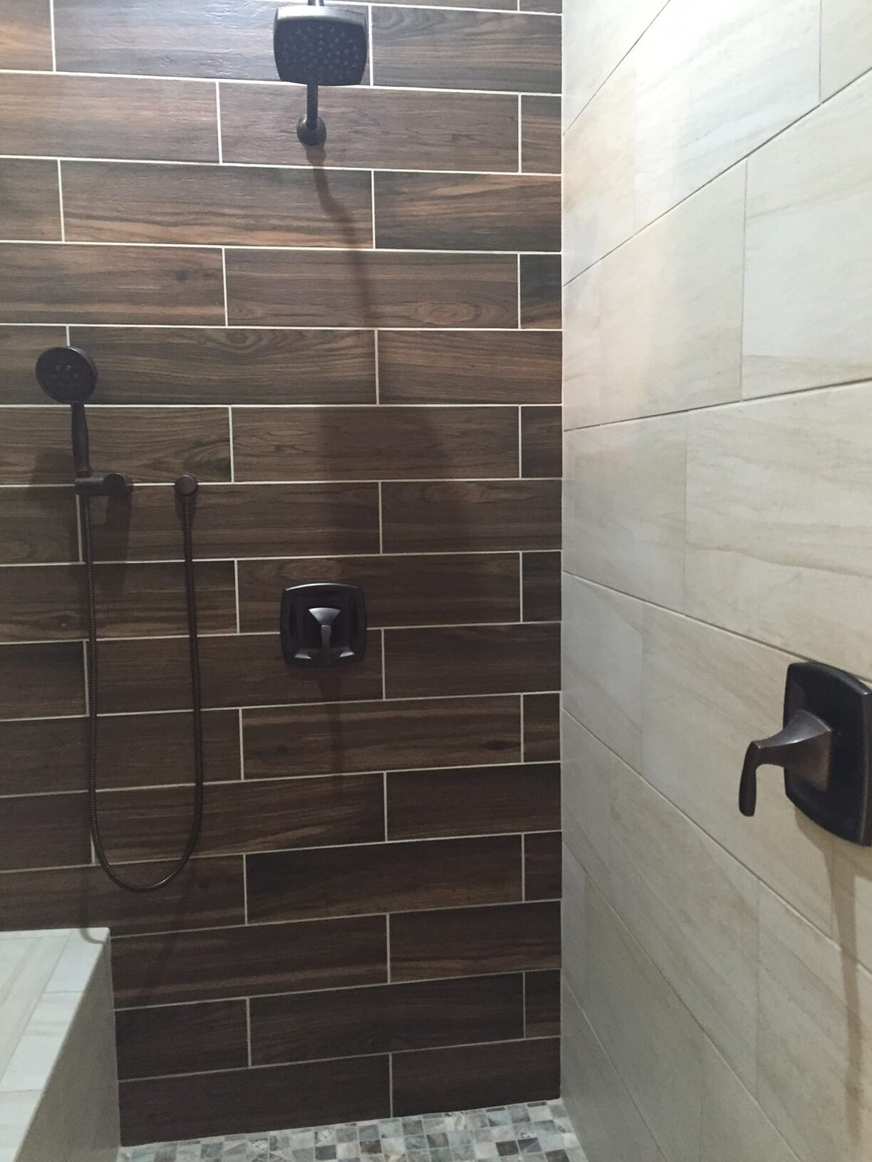 Wood look shower installation in Pasadena, TX from Baytown Floors
