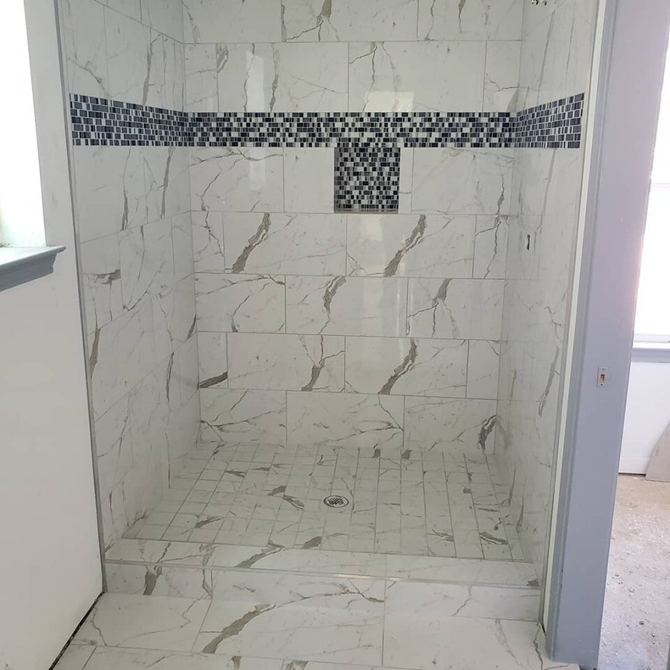 Custom glass tile shower accents in Cypress, TX from Petra Flooring & Blinds