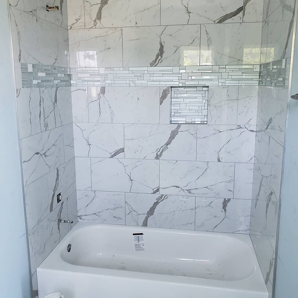 Marble shower installation in Cypress, TX from Petra Flooring & Blinds