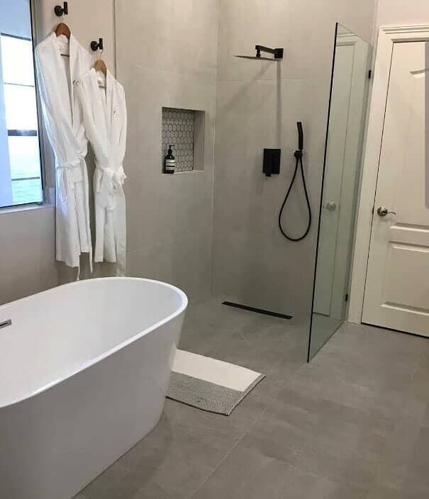 Modern bathroom remodel in Sugar Land, TX from Petra Flooring & Blinds