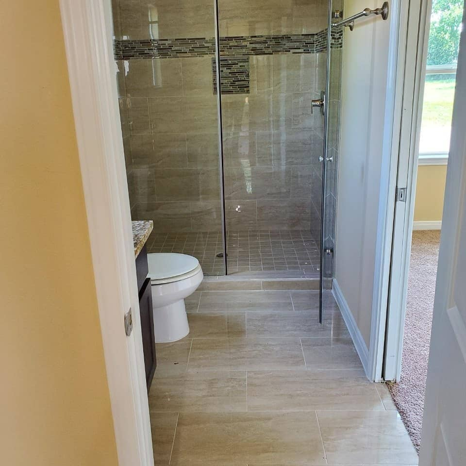 Modern bath remodel in Bellaire, TX from Petra Flooring & Blinds