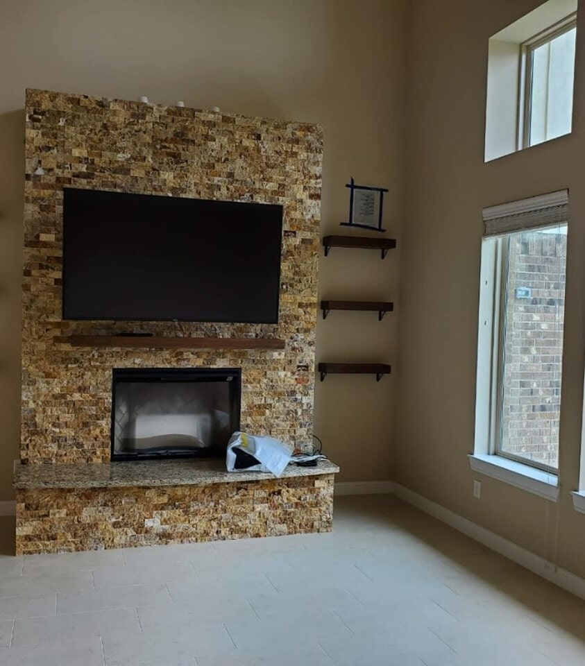 Ledger stone fireplace surround in Pearland, TX from Petra Flooring & Blinds