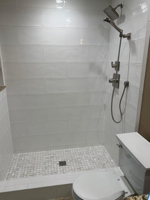 Beautiful white tile shower in Santa Clarita, CA from Dave Walter Flooring Kitchens and Baths