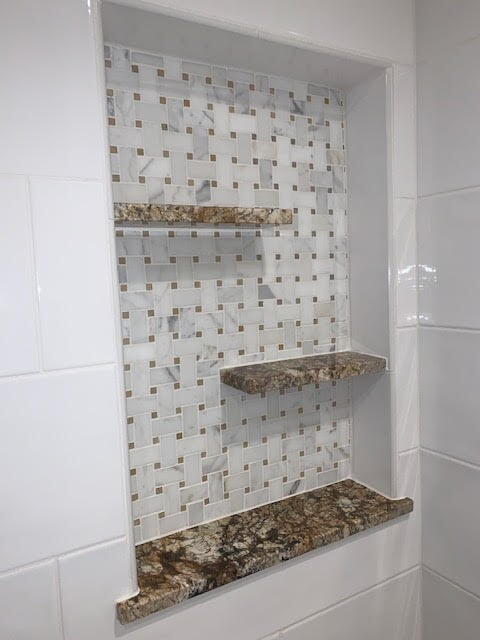 Creative mosaic tile feature in shower in Newhall, CA from Dave Walter Flooring Kitchens and Baths