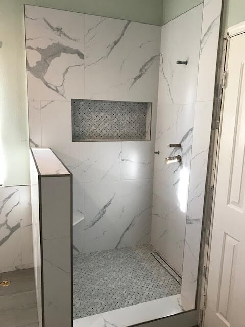 Luxurious marble shower in Valencia, CA from Dave Walter Flooring Kitchens and Baths