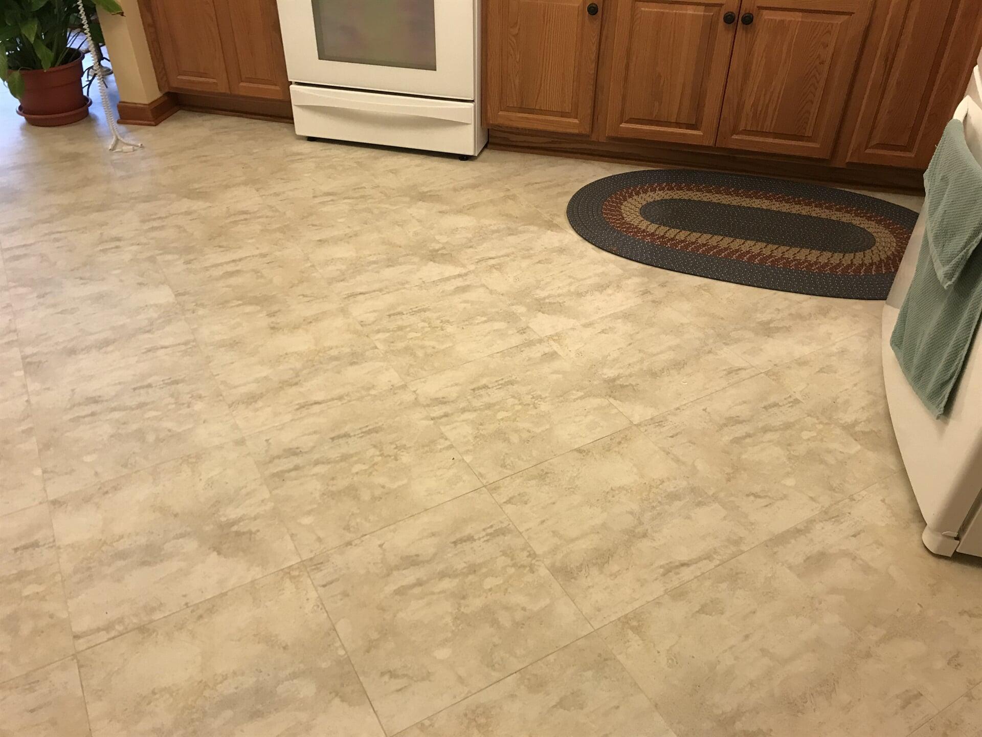 LVT kitchen flooring installation in Kankakee, IL from Marchio Tile & Carpet Inc.