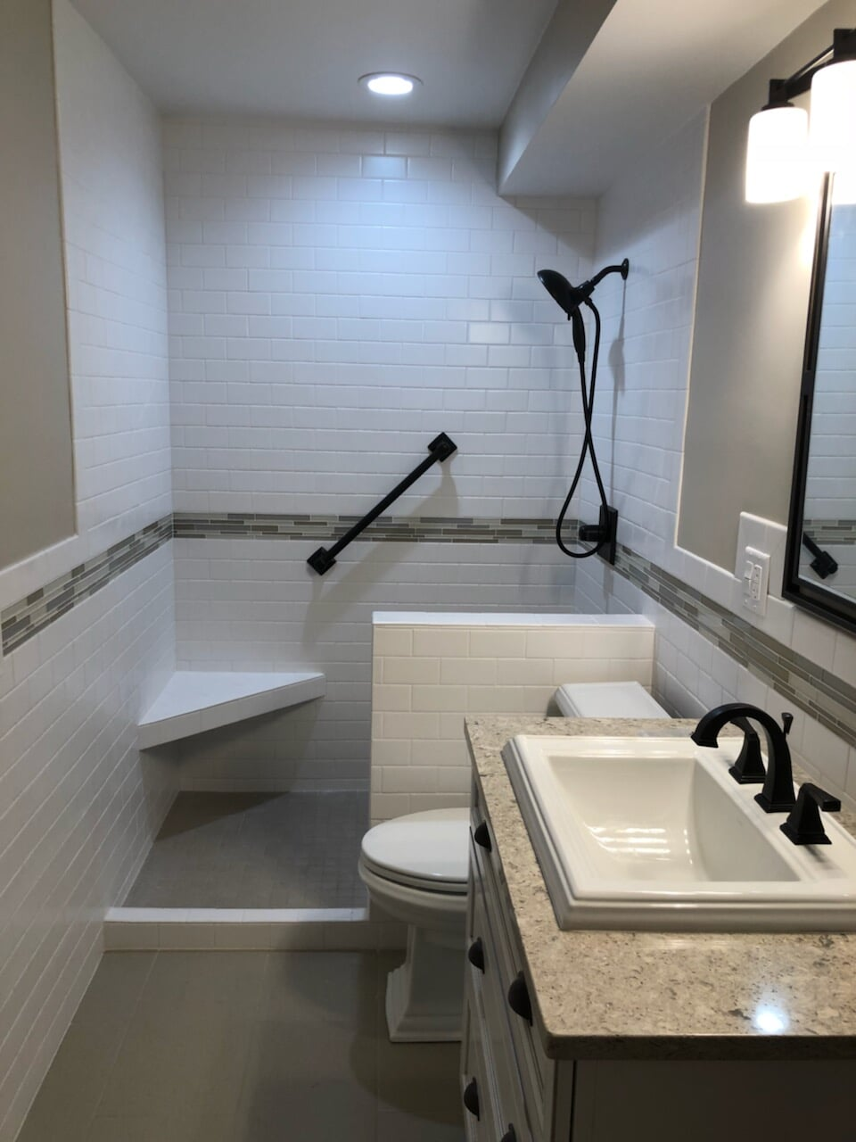 Modern accessible bathroom in New Lenox, IL from Marchio Tile & Carpet Inc.