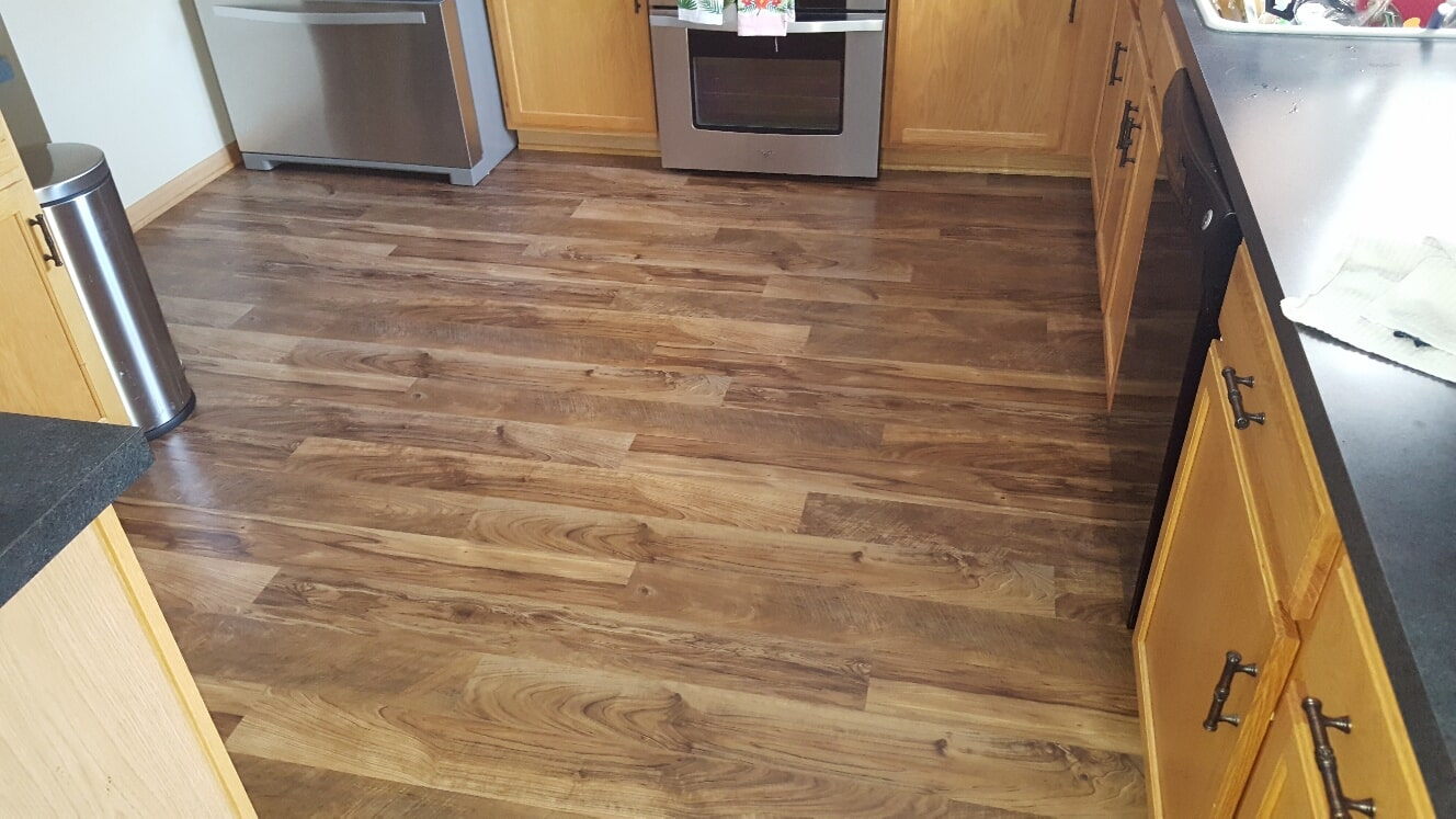 Hardwood look kitchen flooring in Homer Township, IL from Marchio Tile & Carpet Inc.