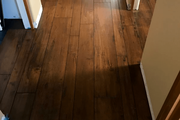 Dark wood look laminate flooring installation in Dewey-Humboldt, AZ