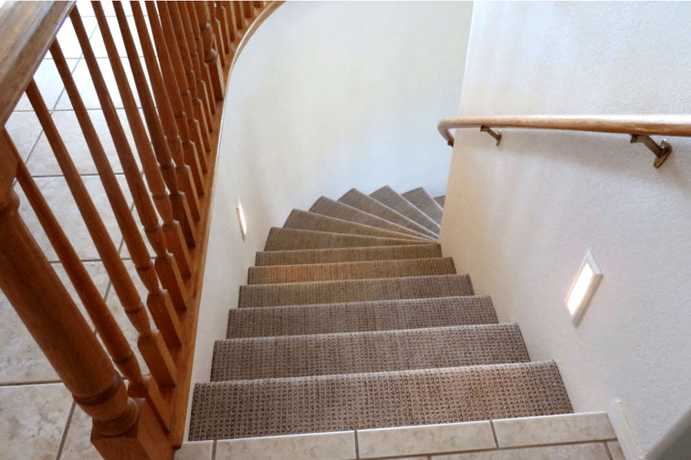 Carpeted stairs with a spiral turn in Prescott, AZ from Prescott Flooring Brokers