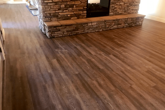 Waterproof flooring around fireplace in Sedona, AZ from Prescott Flooring Brokers