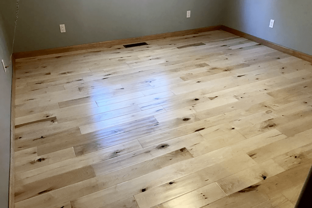 Light tone hardwood with natural knots in Dewey-Humboldt, AZ from Prescott Flooring Brokers
